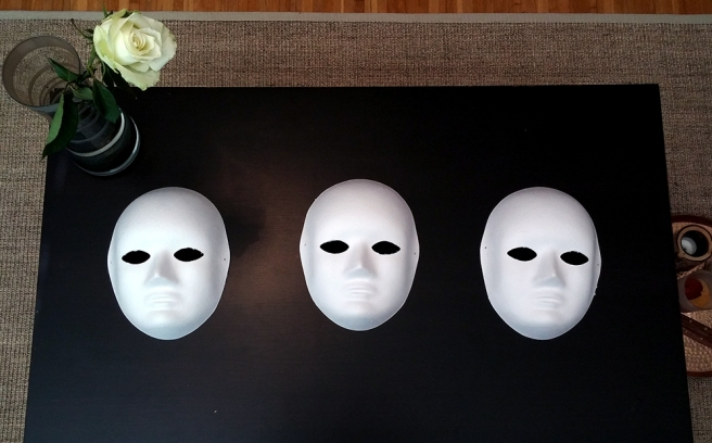 The masks! I actually think they are creepy just like they are, so if you don't want to paint you could simply hang them up straight away, haha.